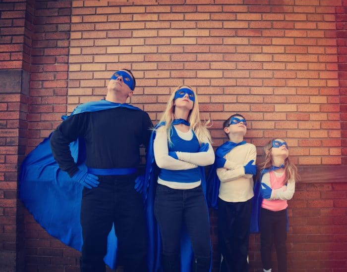 Family dressed in Hero Costumes